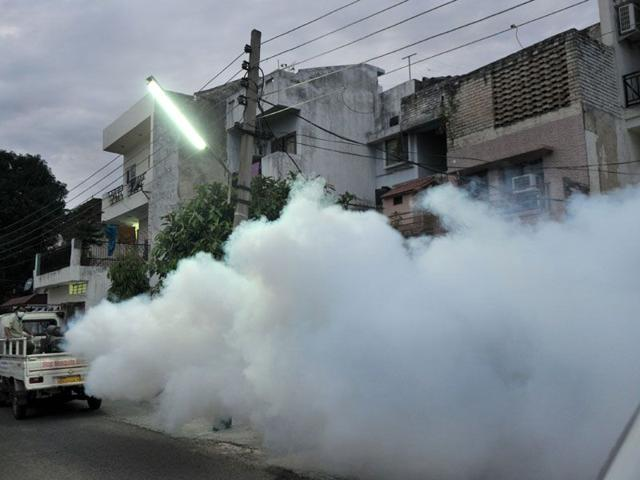 Public health department officials fogging a locality in Sector 41, Chandigarh, on Saturday. (Ravi Kumar/HT)