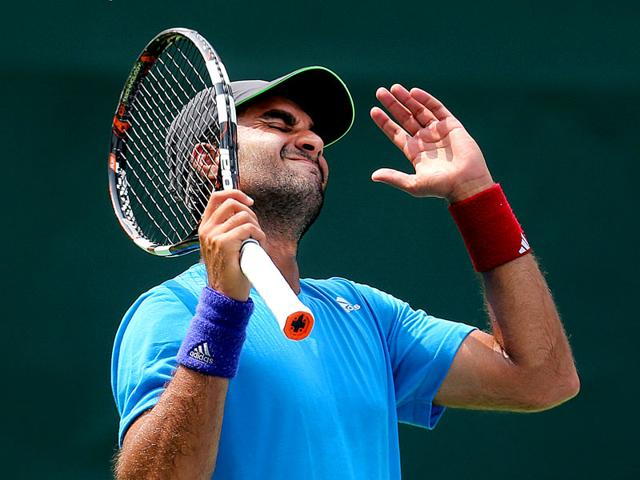 India's Yuki Bhambri reacts after losing a set against Czech Republic's Jiri Vesely during the Davis Cup World Group play-off reverse singles match at the RK Khanna Tennis Complex in New Delhi, on September 20, 2015. (AP Photo)