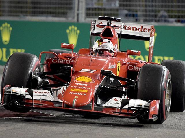 Ferrari's Vettel wins Singapore GP to liven up F1 title race