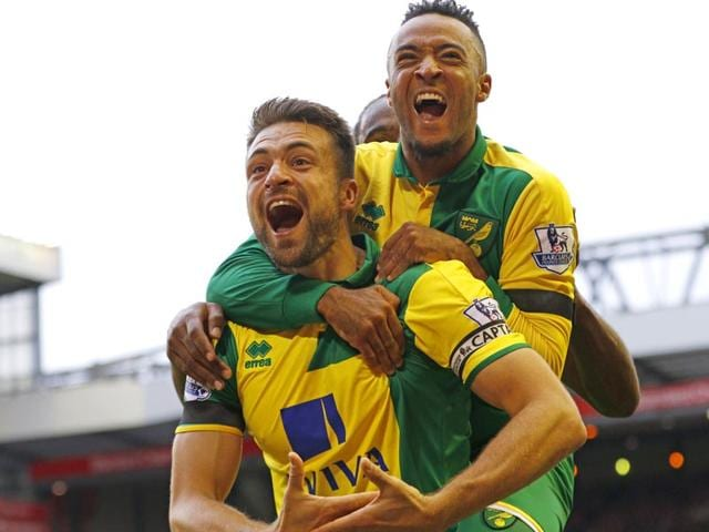 Norwich City captain Russell Martin, lower left, celebrates with teammate Nathan Redmond after scoring against Liverpool in the English Premier League game at Anfield, on September 20, 2015. (Reuters Photo)