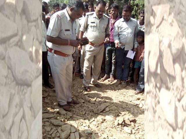 A policeman inspects the site where a drunk man was apparently buried alive. (HT Photo)