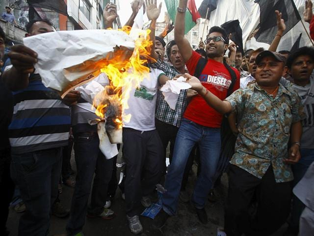 Supporters of opposition parties burn papers symbolizing Nepal's first democratic constitution during a protest against the constitution, in Kathmandu, Nepal. (Reuters)