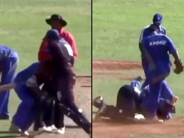 Cleveland County Cricket Club's Jason Anderson in a fight with Willow Cuts Cricket Club's batsman George O'Brien during the Champion of Champions final at the St David's Cricket Club Ground. (YouTube grab)