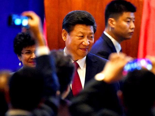Chinese President Xi Jinping arrives for his welcoming banquet on the start of his visit to the United States, at the Westin Hotel in Seattle, Washington. (AFP Photo)