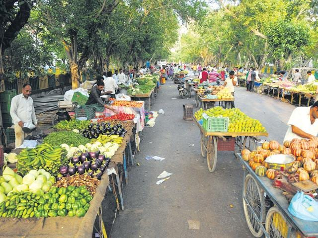 The weekly vegetable market, held on Thursdays, in Sector 48 has been causing heavy traffic congestion in the vicinity. (Burhaan Kinu/ HT Photo)