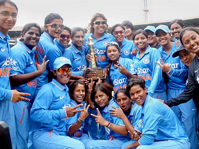 The Indian women's cricket team celebrate with the trophy at Chinnaswamy Stadium in Bangalore after winning the ODI series against New Zealand on July 08, 2015. (PTI Photo)