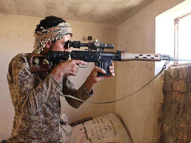 In this photo an IS militant looks through the scope of his rifle in Kirkuk, northern Iraq. Though best known for its horrific brutalities, the IS group has proved to be a highly organized and flexible fighting force. (Photo: Militant website via AP)