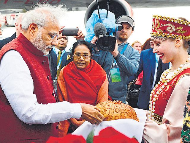 Prime Minister Narenda Modi is offered traditional salt and bread upon his arrival in Ufa, Russia on Wednesday. Ufa hosts the SOC (Shanghai Cooperation Organization) and BRICS (Brazil, Russia, India, China and South Africa) summits (AP Photo)