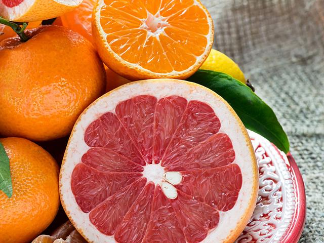 People who consume large amounts of whole grapefruit or orange juice may be at increased risk for melanoma. (Shutterstock photo)