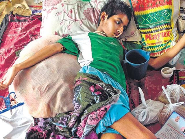 Sayed, 17, lies comatose at the AIIMS waiting hall. His chemotherapy will start only in November. (Arun Sharma/HT Photo)