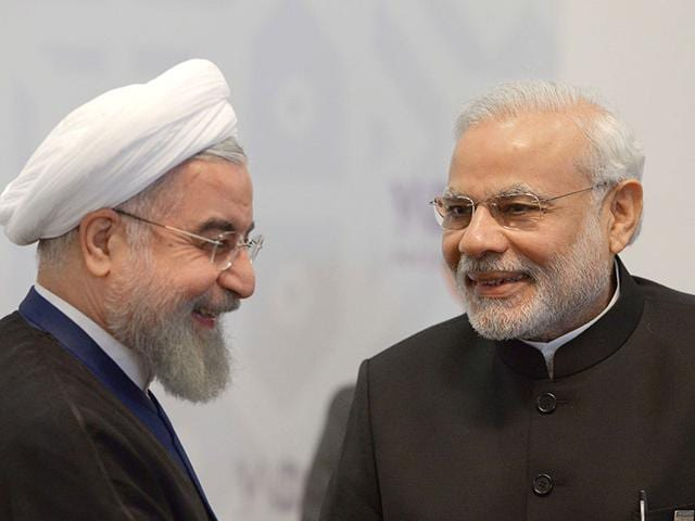 Iran's President Hassan Rouhani (L) meets with PM Modi in Ufa on the sidelines of a summit of the BRICS. (AFP Photo)