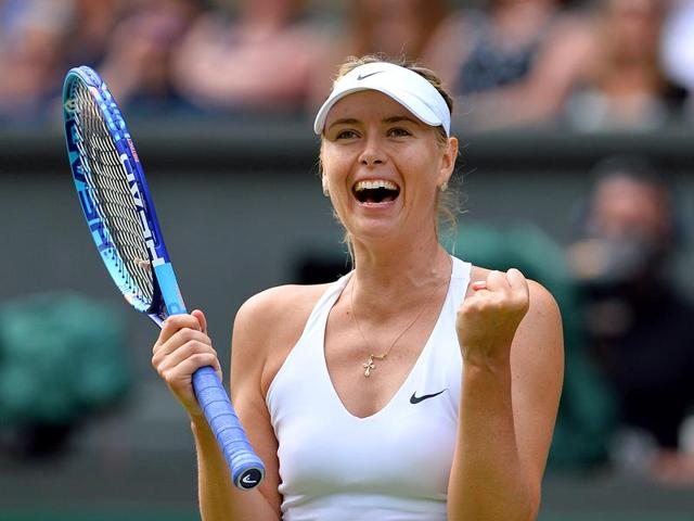 Russia's Maria Sharapova celebrates beating Coco Vandeweghe during their women's quarter-finals match on day eight of the 2015 Wimbledon Championships. (AFP Photo)