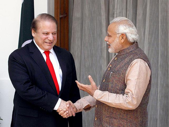 Indian Prime Minister Narendra Modi interacts with Pakistan Prime Minister Nawaz Sharif before a meeting in New Delhi on May 27, 2014. (Photo by Sanjeev Verma/ Hindustan Times)