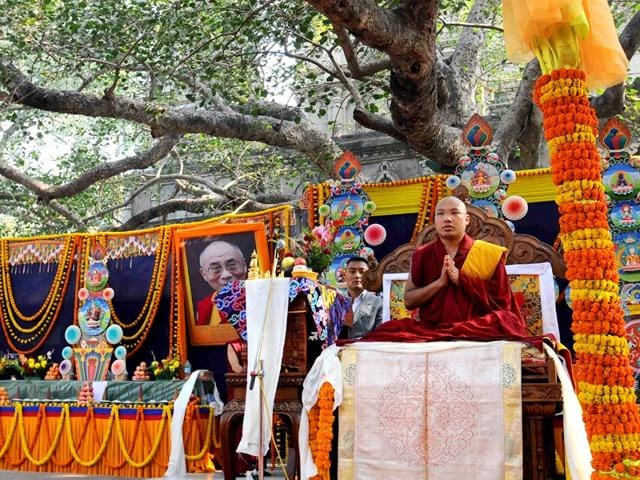 In this file photo, Tibetan spiritual leader Ogyen Trinley Dorje, the 17th Karmapa, offers prayers at the Mahabodhi Temple at Bodhgaya. (AFP Photo)