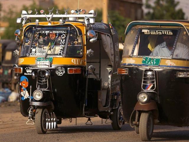 A picture taken on April 16, 2015 shows rickshaws also known as