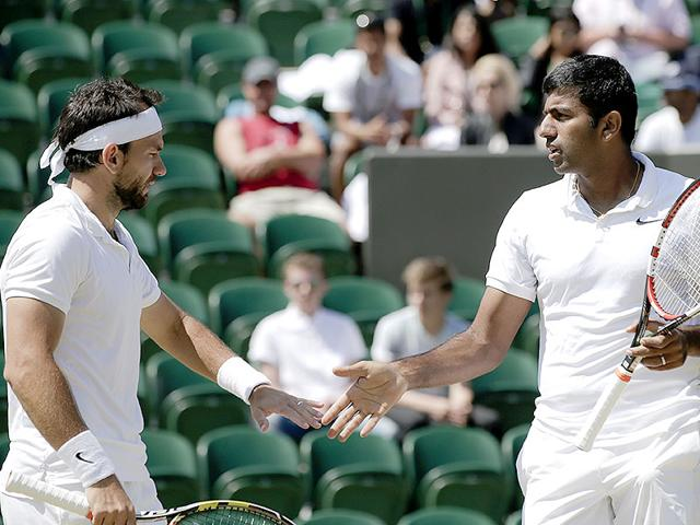 Rohan Bopanna of India, right, and Florin Mergea of Romania during their men's doubles semi-final of the 2015 Wimbledon Championships against Jean-Julien Rojer of the Netherlands and Horia Tecau of Romania at The All England Lawn Tennis and Croquet Club in London, on July 9, 2015. (AP Photo)