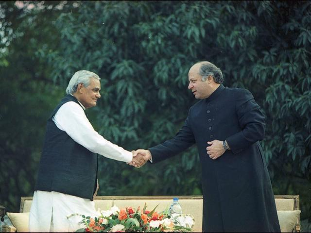 Former PM Atal Bihari Vajpayee shakes hands with Nawaz Sharif during his visit to Pakistan to sign the Lahore Treaty. (File Photo)