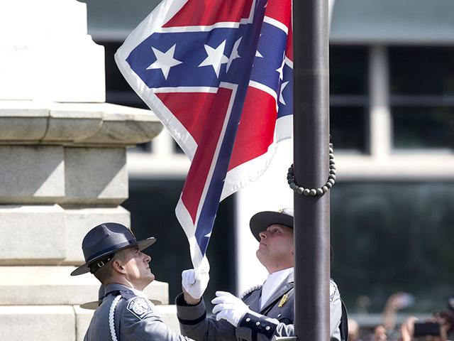 The Confederate battle flag flies on its last full day at the South Carolina state house on July 9, South Carolina. Governor Nikki Haley signed a bill removing the Confederate battle flag from the state house grounds on Thursday afternoon. (AFP)