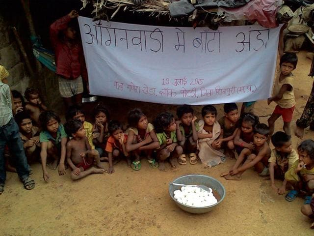 Tribal children enjoyed boiled eggs at Ganeshkheda village in Shivpuri district. (HT photo)