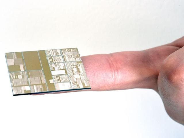 IBM shows a 7 nanometer chip produced at SUNY Poly Colleges of Nanoscale Science and Engineering (CNSE) in Albany. (Darryl Bautista/Feature Photo Service for IBM via AP)