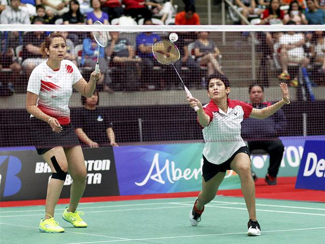 India's Jwala Gutta, left, and Ashwini Ponnappa in action against Dutch pair of Eefje Muskens and Selena Piek in the Canada Open women's doubles final match in Calgary, Canada on June 29, 2015. Gutta and Ponnappa are set to be included in the Target Olympic Podium (TOP) scheme by the Sports Ministry, according to a ministry official. (PTI Photo)