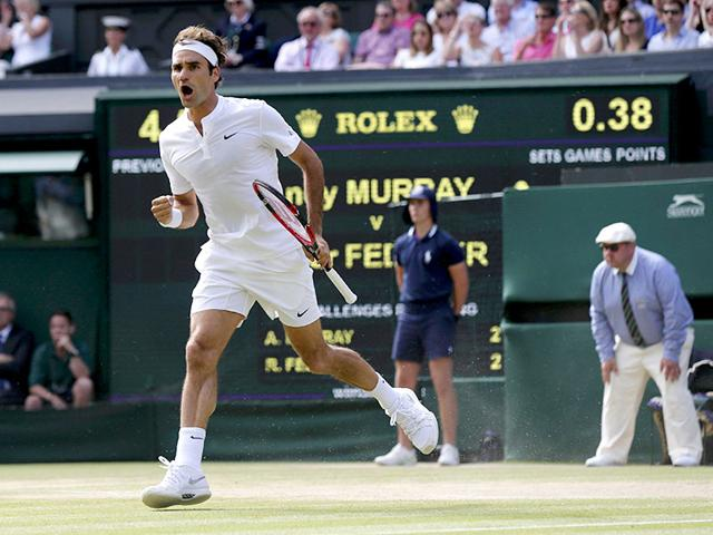 Roger Federer of Switzerland reacts after winning the first set during his men's singles semi-final match of the 2015 Wimbledon Championships against Andy Murray of Britain at The All England Lawn Tennis and Croquet Club in London, on July 10, 2015. Federer won 7-5, 7-5, 6-4. (Reuters Photo)
