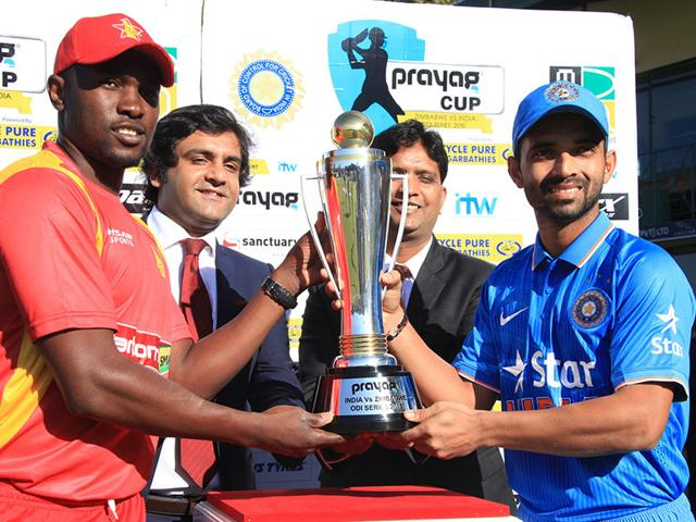 Zimbabwe captain Elton Chigumbura, left, and Indian cricket captain Ajinkya Rahane hold the trophy before the first one-day international between the two teams in Harare, Zimbabwe, on July 10, 2015. Despite scoring 104, Chigumbura couldn't take his team to victory as India escaped with a narrow 4-run win. (AP Photo)