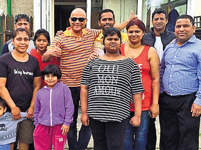 Family of Lington Monteiro (extreme left) with Goan friends Armando Gonsalves (in dark glasses), Jaime Barreto (extreme right) and others in Monteiro's house garden in Swindon. (HT Photo)