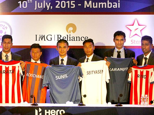 Indian players who were auctioned pose with the jerseys of their respective teams after the 2015 Indian Super League (ISL) auction and draft in Mumbai on July 10, 2015. (Arijit Sen/HT Photo)