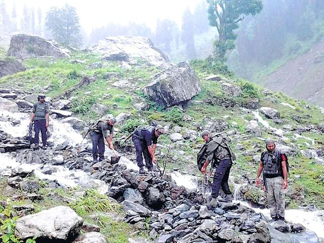 Army personnel look for survivors after 8 people, mostly nomads, were washed away in the cloudburst that struck Adoo area of Pahalgam on Sunday. (PTI Photo)