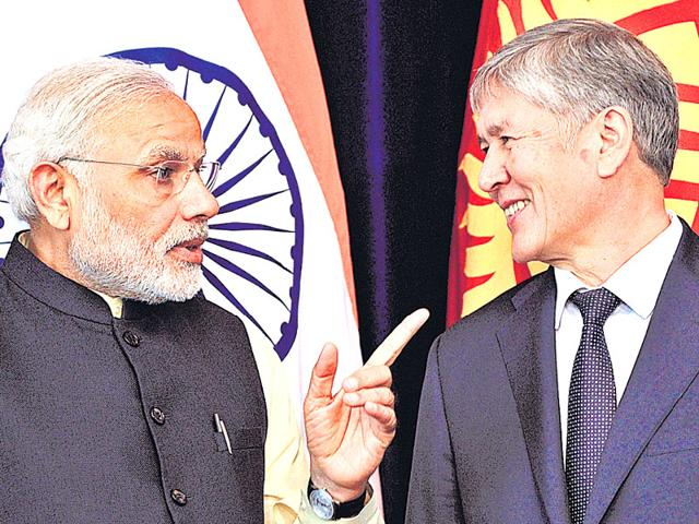 PM Modi gestures to Kyrgyz President Almazbek Atambayev at the Ala-Archa state residence in Bishkek on Sunday. (AFP Photo)