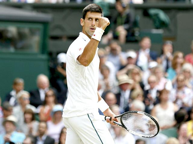 Novak Djokovic of Serbia reacts during the men's singles final match of the 2015 Wimbledon Championships against Roger Federer of Switzerland at The All England Lawn Tennis and Croquet Club in London, on July 12, 2015. (Reuters Photo)