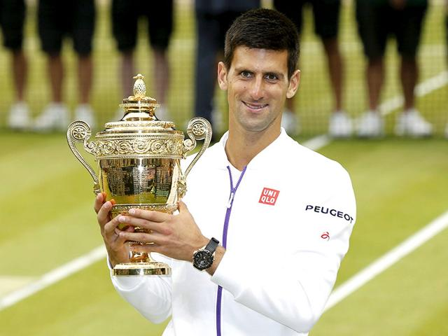 Novak Djokovic of Serbia poses with the winner's trophy after winning the men's singles final of the 2015 Wimbledon Championships against Roger Federer of Switzerland at The All England Lawn Tennis and Croquet Club in London. (Reuters Photo)