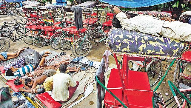 After pedalling for 12-15 hours a day, they sleep in makeshift structures where rickshaws are parked. (Arun Sharma/HT Photo)