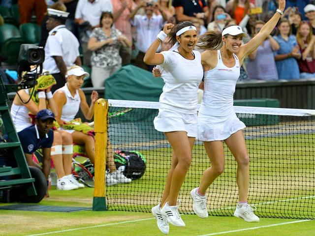 Martina Hingis of Switzerland, right, and Sania Mirza of India smile after winning the second set of their women's doubles final of the 2015 Wimbledon Championships against Elena Vesnina and Ekaterina Makarova of Russia at The All England Lawn Tennis and Croquet Club in London, on July 11, 2015. (Reuters Photo)