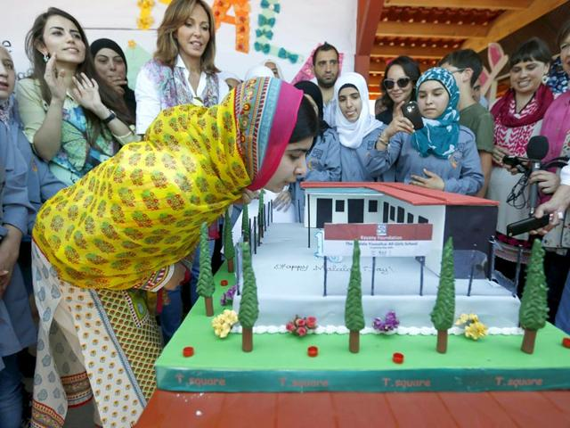 Nobel Peace Prize laureate Malala Yousafzai blows out candles on her birthday cake at a school for Syrian refugee girls, built by the NGO Kayany Foundation, in Lebanon's Bekaa Valley. (Reuters Photo)