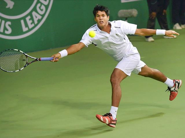 Somdev Devvarman (file pic) overcame stiff resistance from American Daniel Nguyen to win the rain-hit final that lasted three hours and 31 minutes, the longest summit clash in the ATP Challenger Tour history. (PTI Photo)