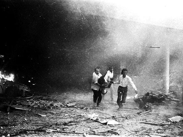 File photo of people rushing a victim to the hospital from Air India building after the bomb blast in 1993. On March 12, 1993, within a span of two hours, a series of 12 bomb explosions rocked Mumbai killing 257 and leavingmore than 700 people injured. (PTI photo)