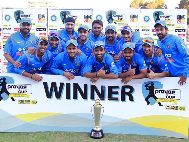 Team India poses with the trophy after winning the ODI series 3-0 against Zimbabwe in Harare on July 14, 2015. (AP Photo)