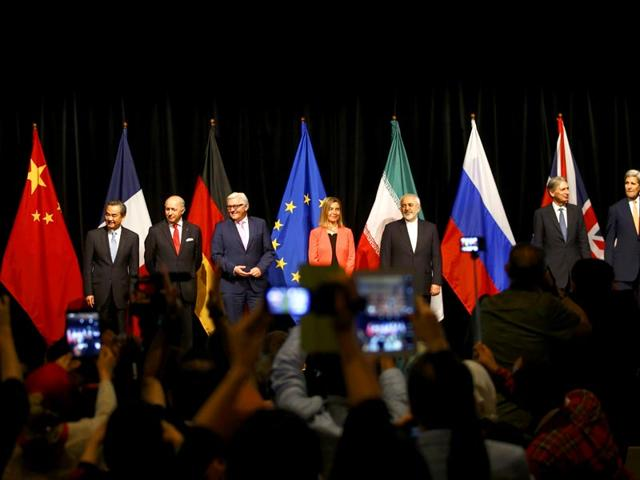 Foreign ministers of P5 +1 pose for a group photo after the last plenary session at the United Nations building in Vienna on Tuesday. Iran and six major world powers reached a nuclear deal on Tuesday. (Reuters Photo)