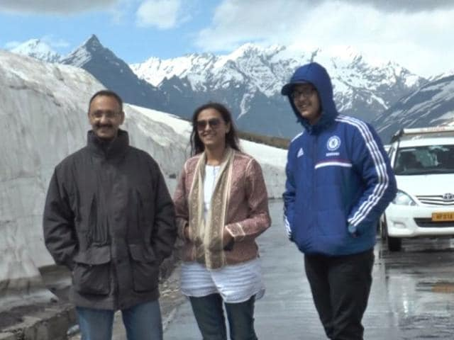 National Green Tribunal deputy registrar Sheetal Sharma (centre) with her husband and son during an official visit to the Rohtang Pass near Manali on June 22. HT photo