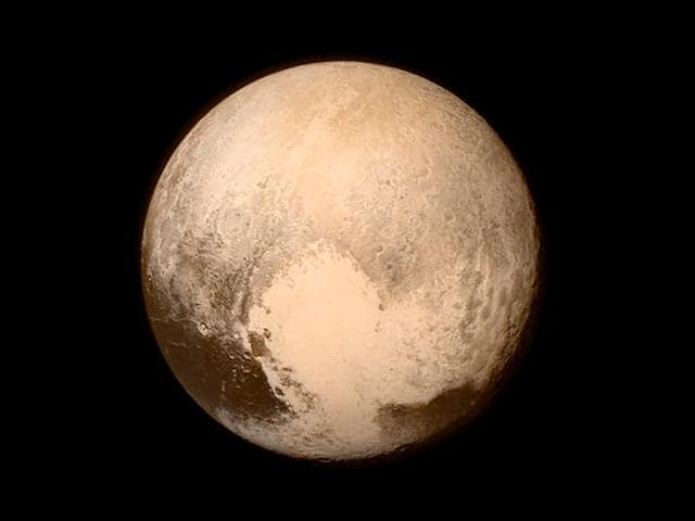 Pluto (R) and its moon Charon are pictured from about 6 million kilometers in this Nasa handout photo from the New Horizons' Long Range Reconnaissance Imager. (Reuters)