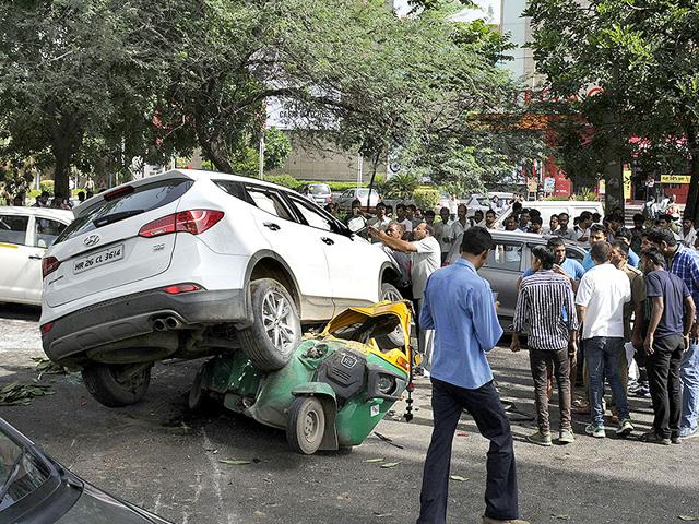 Three unknown car borne youths fired gunshots at another car ferrying a locally known gangster on MG Road, Gurgaon, on Wednesday morning in suspected gang war rivalry. (HT Photo)