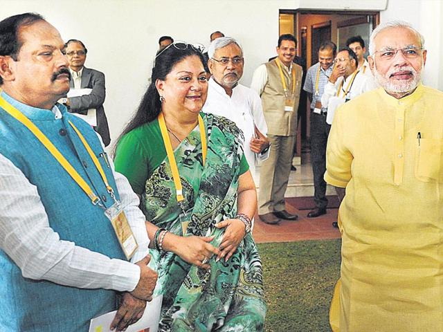 PM Narendra Modi interacts with Rajasthan CM Vasundhara Raje and Jharkhand CM Raghubar Das ahead of the second meeting of the Niti Aayog's governing council here on Wednesday. (PTI Photo)