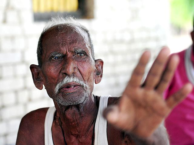 Ram Janam Mauriya, who is struggling to prove to authorities that he is still alive after being declared dead by his younger brother, talks outside his home in Uttar Pradesh's Azamgarh district. (AFP Photo)