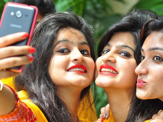 Students taking selfie at Guru Gobind Singh College for Women (GGSCW)campus after attending their classes on the first day of new session at sector 26, Chandigarh