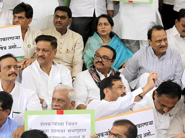 Congress and NCP MLAs staged a protest and demanded farm loan waiver at Vidhan Bhavan, in Mumbai. (Kunal Patil/HT photo)
