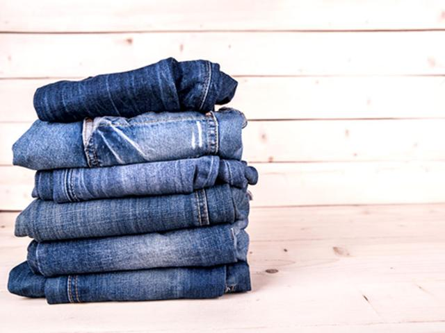Denims are big this season! Both luxury and high street brands are paying homage, rediscovering the traditional workwear fabric's potential and producing them in a myriad of washes. (Shutterstock photo)