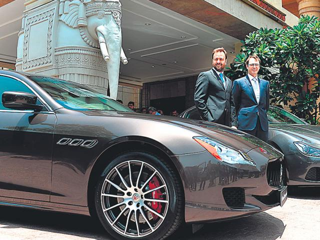 Maserati's network development manager Bojan Jankulovski (right) at the re-launch of the brand in New Delhi on Wednesday. Photo:AFP