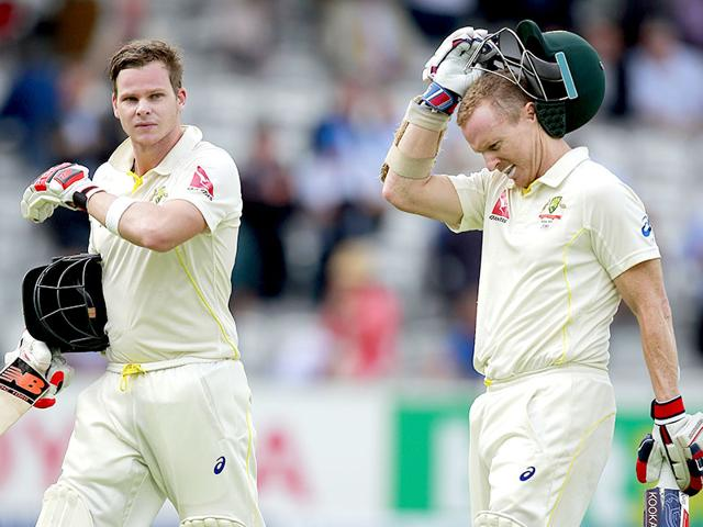 Australia's Steve Smith, left, and Chris Rogers walk off the field at the end of the first day of the second Ashes Test against England. Rogers scored 158 and Smith 129 to help Australia to 337/1 at the end of day's play. (Reuters Photo)
